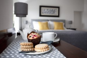 Tea cake and biscuits in a luxury bedroom