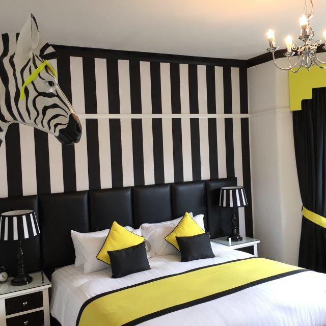 Main bedroom with chic styling in boutique accommodation