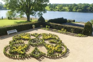 Relax and enjoy Combermere Abbey's lake views and gardens