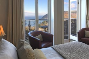 Cushions on bed overlooking Lynton