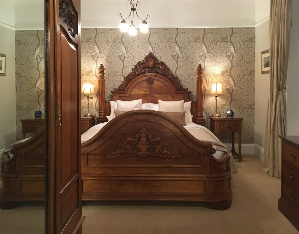 Period style bed in luxury bedroom